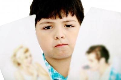 upset-boy-with-pics-of-parents